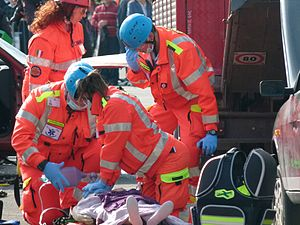 English: Italian EMTs performing CPR on an moc...