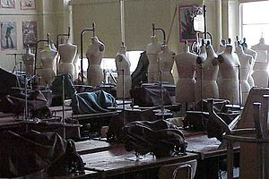 A classroom filled with sewing machines and ma...
