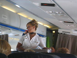 English: Stewardess in a Swiss flight